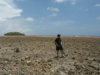 Dick Spink stands on the rocky beach near Barre Island where he believes Amelia Earhart landed her Electra 10E on July 2, 1937. Spinks' compelling discoveries on Mili's Endriken Islands have been met with abject silence by a media that refuses to face the truth in the Earhart disappearance.