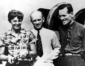 Perhaps the last photo taken before the flyers' July 2 takeoff from Lae, New Guinea. Mr. F.C. Jacobs of the New Guinea Gold Mining Company stands between Amelia and Fred. Note that Fred looks chipper and ready to go, not hung over from a night of drinking, as has been alleged.
