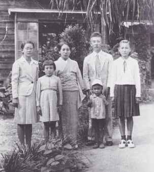 Mikio Suzuki, the district chief of police, poses with his family on Saipan circa 1938. Mikio's daughter, Michiko, is standing to his immediate left, and was about 12 years old in this photo. Michiko became Mrs. Michiko Sugita, and remains the lone Japanese national to come forward with the truth about Amelia Earhart's death on Saipan. (Courtesy Thomas E. Devine.)
