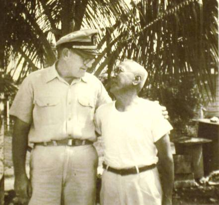 Cmdr. Paul W. Bridwell, chief of the U.S. Naval Administration Unit on Saipan, and Jose Pangelinan, who told Fred Goerner he saw the fliers but not together, that the man had been held at the military police stockade and the woman kept at the hotel in Garapan. Pangelinan said the pair had been buried together in an unmarked grave outside the cemetery south of Garapan. The Japanese had said the two were fliers and spies. (Photo by Fred Goerner, courtesy Lance Goerner.)